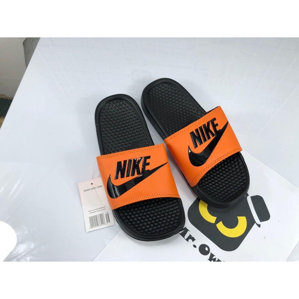 nike slippers black and orange